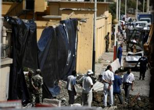 Algerian soldiers and municipal workers stand at site of