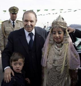 Algeria's President Abdelaziz Bouteflika pose with children at a