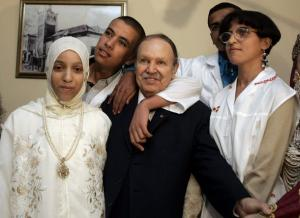 Algeria's President Abdelaziz Bouteflika (C) pose with children at